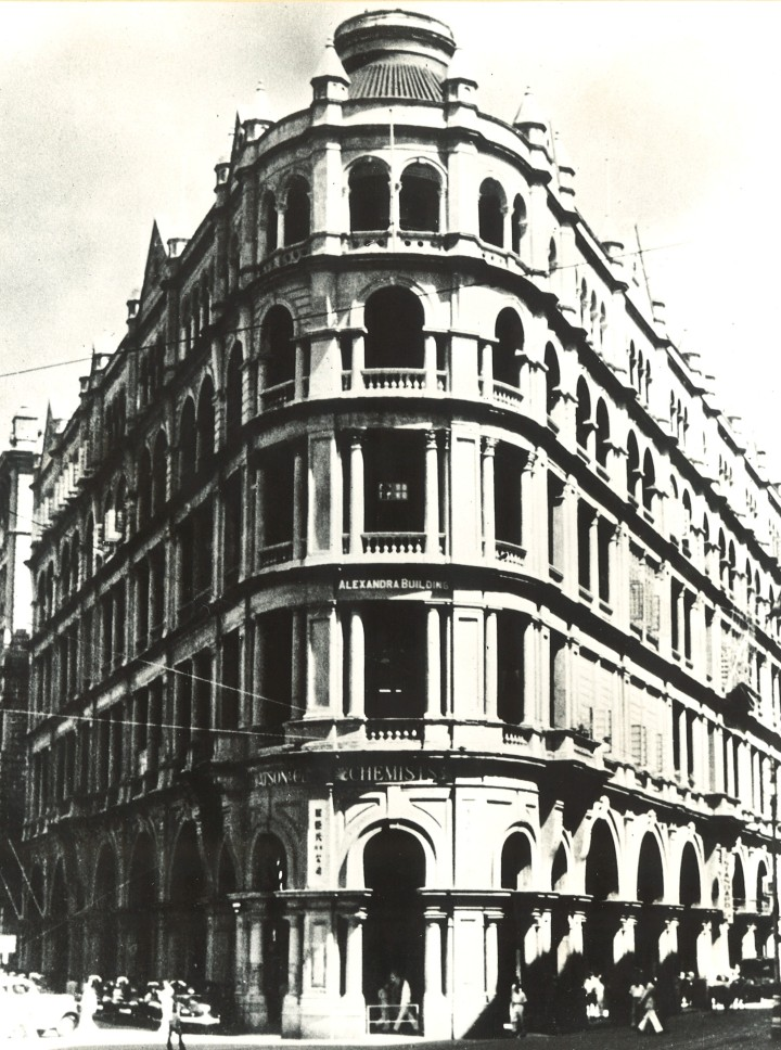 This was the triangular western part of the site owned by HKL, whose original lease dates from October 1904. The Chater Road section was let to various shops from time to time, and the Veoux Road side was let in similar manner for many years to A.S. Watson and Co., to Komor & Komor, and to the Hong Kong Stock Exchange. The building was a five-storey flat roof construction. Alexandra Building and Royal Building were demolished in the 1950s in favour of a 13-level block, Alexandra House, and completed in 1956. This in turn was demolished in 1975 and a new 34-level tower and podium has risen in its place.