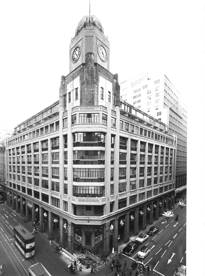 On New Year's Day 1926, a larger portion of the old Hong Kong Hotel (the part on the Des Voeux Road Central & Pedder Street corner) was completely gutted by fire. The company bought this site (26,000 sq.ft) in 1928 for $1,375,000 and developed on it the Gloucester Building which was completed in 1932. The clock surmounting its corner tower becoming one of Central Victoria's landmarks until 1977 when Gloucester Building was demolished. One of the first post-war decisions made by the Secretary, Mr Bevan Field, was to move HKL offices from Queen's Building to the first floor of Gloucester Building.